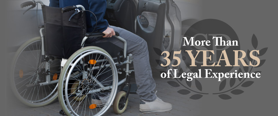 More than 35 years of legal experience | In a wheelchair