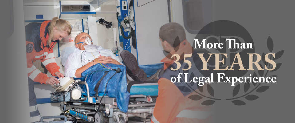 More than 35 years of legal experience | Loading patient into ambulance